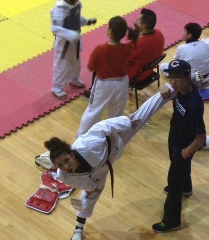 Freshman Natali Tzvetkvova warms up before she competes. Tzvetkvova is a nation TaeKwonDo champion.
