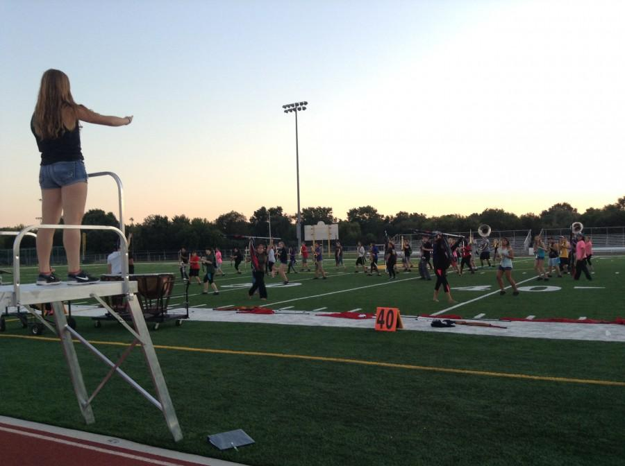 MARCHING+GRENS+PRACTICE%3A+Senior+and+drum+major+Kathryn+Riopel+conducts+the+Marching+Grens+before+competition.