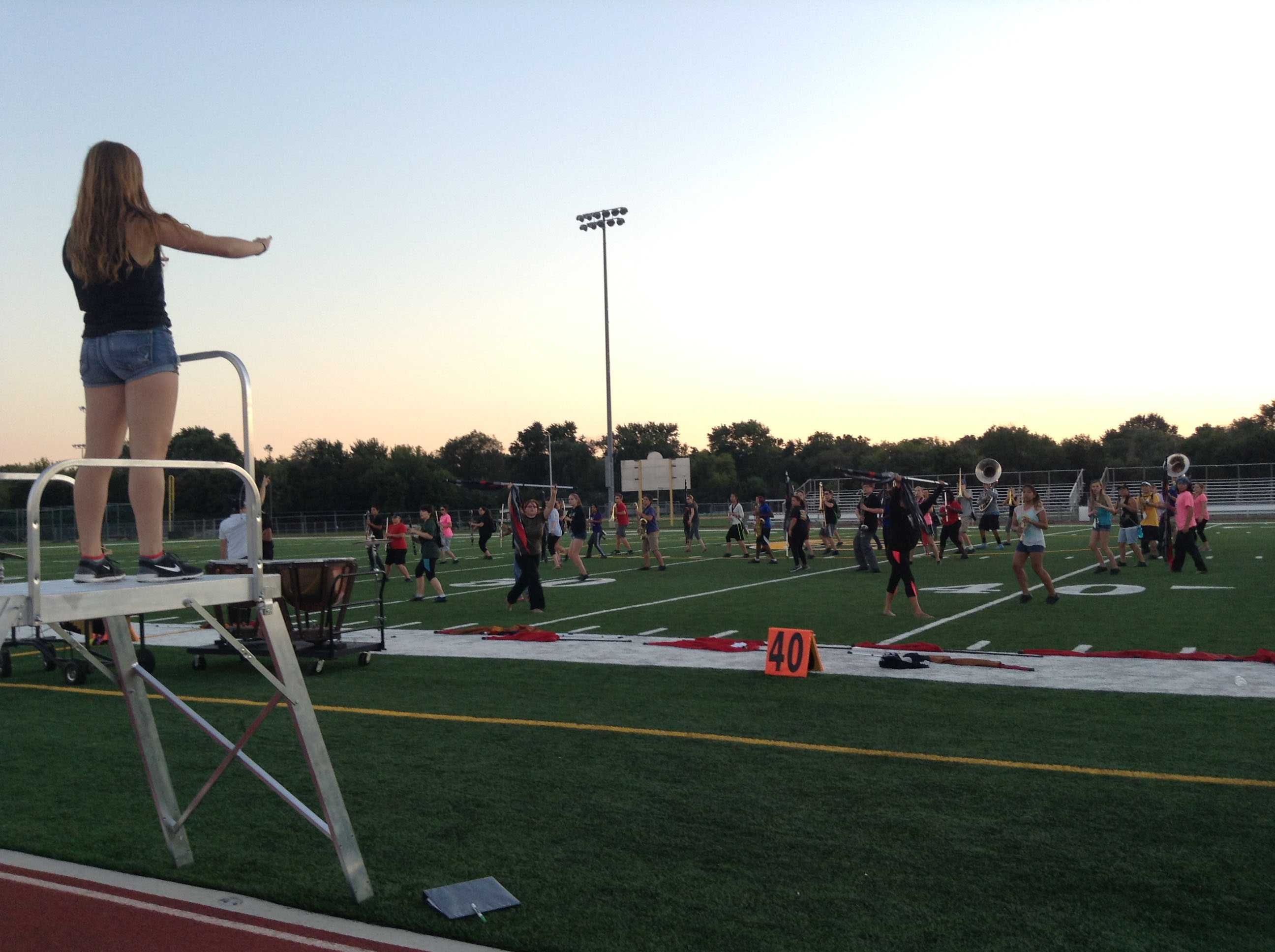 MARCHING GRENS PRACTICE: Senior and drum major Kathryn Riopel conducts the Marching Grens before competition.
