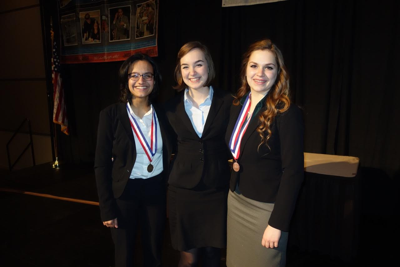 Victory: From left to right, Megan Manoj, Emily Franke, and Kathryn Riopel after the award ceremony at the Peoria Civic Center