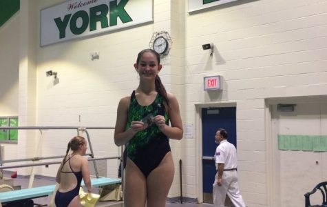 Sophomore breaks school records, dives into finals