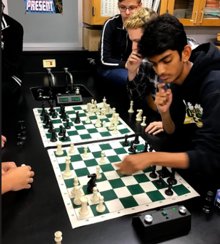 Senior Kunal Patel focuses on his next move during a chess practice.