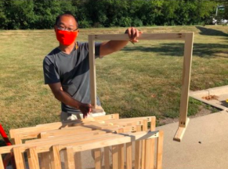 Keith Mukai, pictured here with one of his desk shields, made the shields for Elk Grove teachers for when they return in close proximity to students.