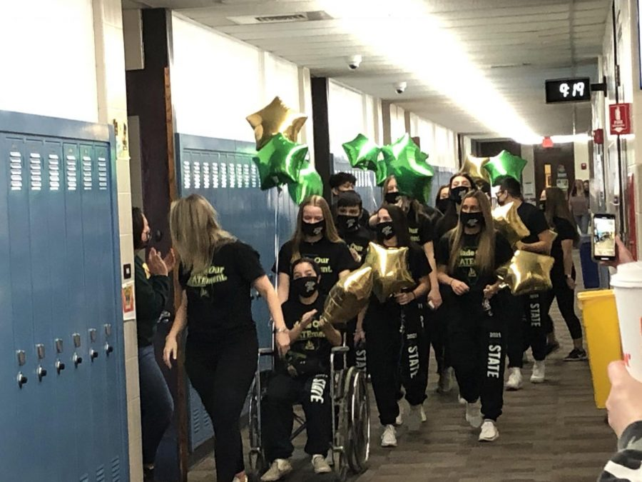 The Elk Grove High School co-ed cheerleading team marches down the English hallway during the team's state send-off. Photo by adviser Kevin Modelski