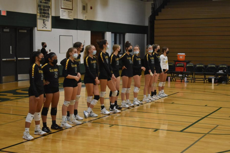 The girls volleyball team lines up before the start of a home game against Fremd High School