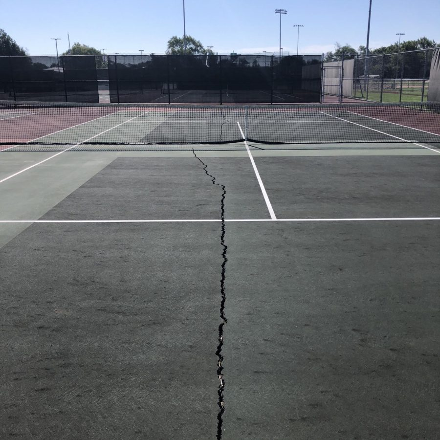 A crack down the middle of one of Elk Groves tennis courts.